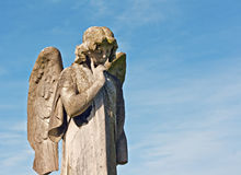 Winged angel statue in graveyard Royalty Free Stock Photos