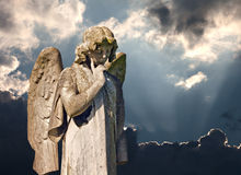 Winged angel statue in graveyard Stock Photography