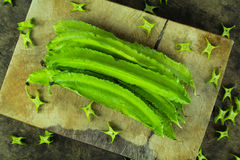 Winged beans on wooden background. Princess bean, Goa bean Royalty Free Stock Photos
