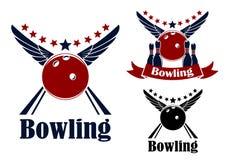 Winged bowling ball and ninepins Royalty Free Stock Image