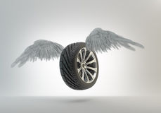 Winged car wheel Stock Images