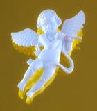 Winged cherub playing flute Stock Image