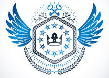 Winged classy emblem, vector heraldic Coat of Arms created using. Security keys, royal crown and stars Stock Image