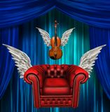 Winged comfort chair and violin Stock Photo