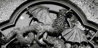 Winged creature. Shot in black and white, detail on an sculpture representing a strange creature with wings placed on Central Park, New York City, USA, America Royalty Free Stock Images