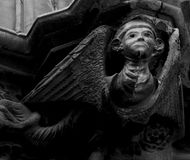 The winged creature. Shot in black and white. Sculpture on the facade of the Cathedral, representing a winged creature. Set in Barcelona, Gothic, Catalunya Royalty Free Stock Photo
