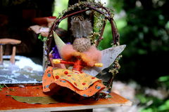 Winged faerie seated in Faerie Chair Stock Image