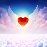 Winged heart. Digital painting - red chrome heart, matte glass wings, epic background Royalty Free Stock Images