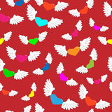 Winged hearts. Of different colors on a red background Stock Photo