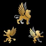 Winged Lion ancient emblems elements set. Heraldic vector design Royalty Free Stock Images