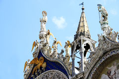 Winged lion and angels decorating Venetian church Stock Photo