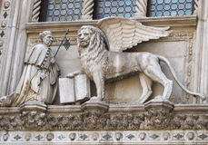 Winged lion with the book. Apostle Mark and its symbol - the Winged lion with the book. Venice. Italy Stock Image