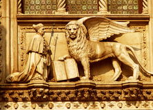 A winged lion with a priest. Venice, 2006, Italy Stock Photo