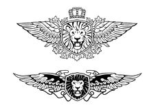 Winged Roaring Lion Shield Insignias stock photos