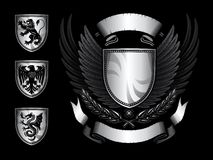 Winged Shield Insignia. With Eagle, Lion, Dragon emblem Royalty Free Stock Image