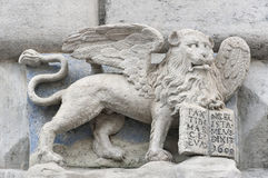 The winged St Mark`s Lion holding gospel in Lviv, Ukraine. The winged St Mark`s Lion holding gospel with inscription PAX TIBI MARCE EVANGELISTA MEVS May Peace be Royalty Free Stock Images