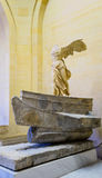 The Winged Victory of Samothrace. Also called the Nike of Samothrace, ancient Greek marble statue in the Louvre Museum, Paris, France Royalty Free Stock Photography