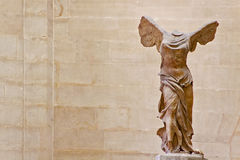 THE WINGED VICTORY OF SAMOTHRACE IN LOUVRE. There are many amazing and well-known artwork in Louvre, The Winged Victory of Samothrace is one of those sculptures Royalty Free Stock Images