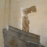The Winged Victory of Samothrace. Masterpiece attraction at The Louvre Museum in Paris France Royalty Free Stock Photo