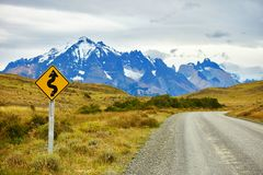 Winging road sign in Torres del Paine Royalty Free Stock Images