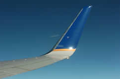 Winglet. Of an aircraft from the inside on a blue sky Royalty Free Stock Photo