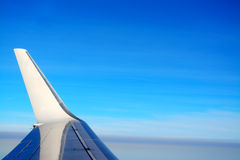 Winglet in the blue sky. Airplane winglet in the blue sky Royalty Free Stock Image