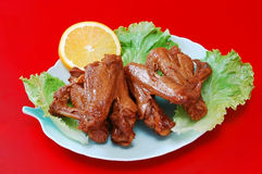 Wings. Spicy poultry wings with lemon stock photos