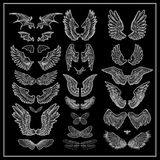Wings. Vector set of wings isolated on black background Stock Images
