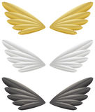 Wings. Gold, white and black wings isolated on white background Stock Photography
