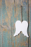Wings of angel hanging on wooden background Stock Photo
