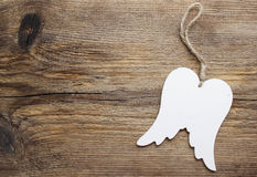 Wings of angel on wooden background Royalty Free Stock Photography