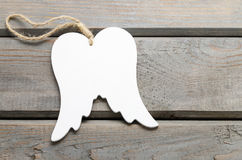 Wings of angel on wooden background Royalty Free Stock Images