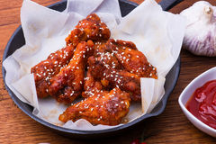 Wings on Cast Iron Pan Royalty Free Stock Image