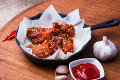 Wings on Cast Iron Pan Royalty Free Stock Photo