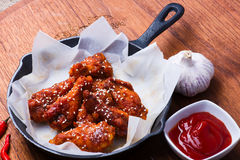 Wings on Cast Iron Pan Royalty Free Stock Images