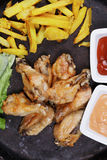 Wings with chips above view Royalty Free Stock Image