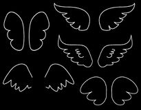 Wings collection vector illustration set with white angel wings. Wings collection vector illustration set with white angel or bird wing icon isolated on black Stock Image