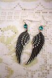 Wings earrings Royalty Free Stock Image