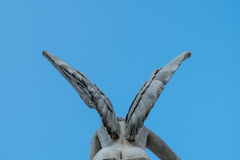 Wings of female angel statue on blue sky Stock Image