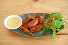 Wings fied chicken on dish in thai menu Stock Images