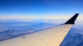 Wings over the mountains of California on a clear sunny day, en route to Hawaii. royalty free stock photos