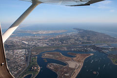 Wings Over San Diego Bay. Aerial view of San Diego Bay on a sunny day. Image is framed by the wing and wing strut off a private aircraft Stock Photography