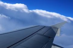 Wings of a plane. This is the wings of a plane in mid-air Stock Photography