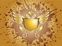 Wings And Shield Splash Gold Stock Photos