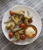 Wings  with  tomatoes from above Stock Images