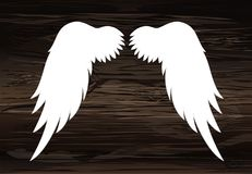 Wings. Vector illustration on wooden background. Black and white. Style Stock Images
