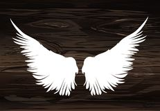 Wings. Vector illustration on wooden background. Black and white. Style Stock Photo