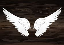 Wings. Vector illustration on wooden background. Black and white. Style Stock Photography