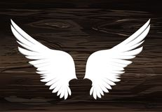 Wings. Vector illustration on wooden background. Black and white. Style Stock Image