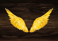 Wings. Vector illustration on wooden background. Golden color. Gold metal stock illustration